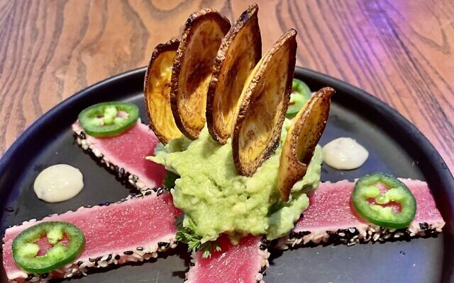 Tuna tartar is bold and bright with jalapeños and guacamole.