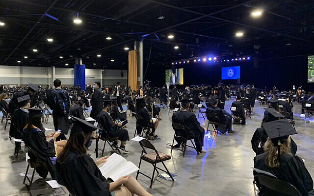 Emory Twitter // Students graduate from Emory University at the Georgia World Congress Center.