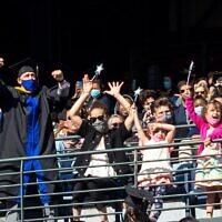 Georgia State Facebook // Georgia State graduates in Center Parc Stadium.