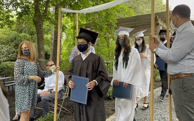David Academy Graduates walk under the Chuppah.