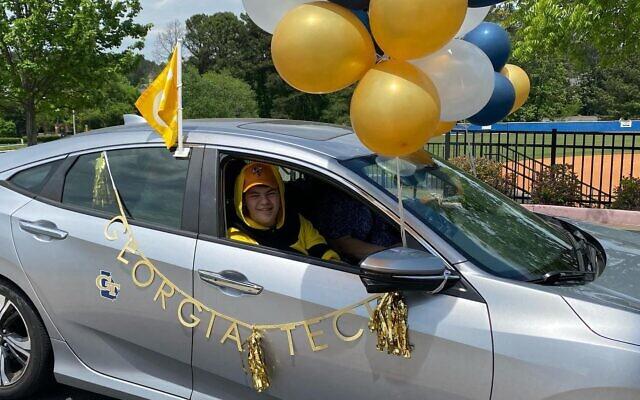 A students decoroartes his car with Georgia Tech swag.