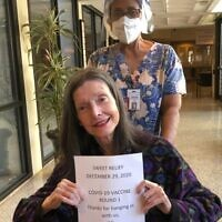 Photo courtesy of Jewish HomeLife // Resident Carol Cohn about to enter the first vaccine clinic Dec. 29.