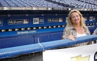 Then and now: Marlene Colon in the Braves dugout. A special tribute to Colon was shown at a recent Braves game.