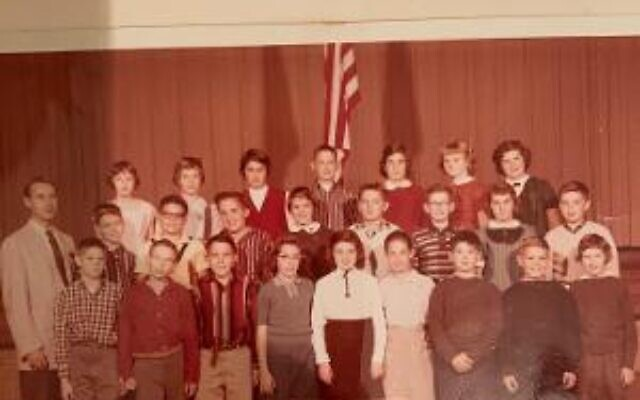 Marlene Colon with her elementary school class in Cleveland, Ohio. She's in the middle row, in the middle, with the white collar.