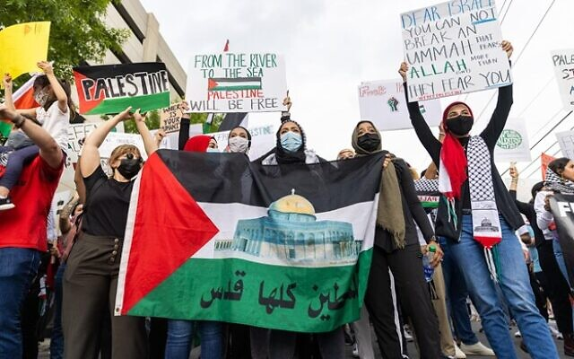 Pro-Palestine protestors are seen on the sidewalk during a protest outside the Israeli consulate. // Nathan Posner for the AJT