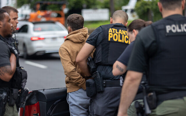 Atlanta Police Department arrest a protestor for doing burnouts during a pro-Palestine protest. // Nathan Posner for the AJT.