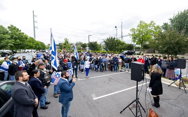 Photos by Nathan Posner for the AJT// Rabbi Shuval-Weiner speaks at the rally in Sandy Springs on May 12, 2021.