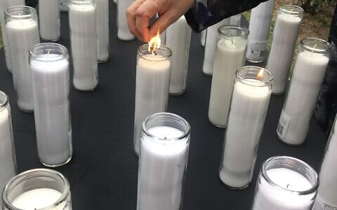 Memorial attendees lit candles in memory of those who died in the stampede.