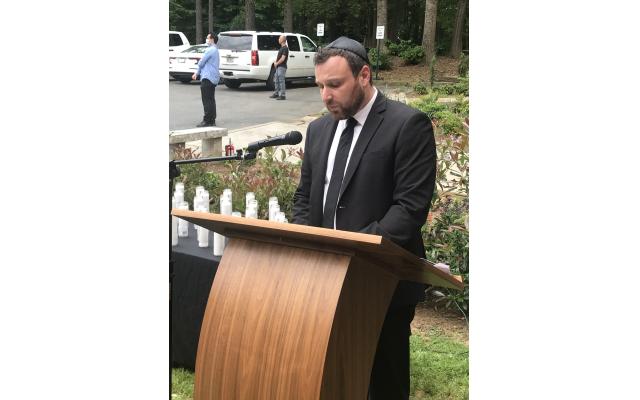 Deputy Consul General Alex Gandler leads prays.