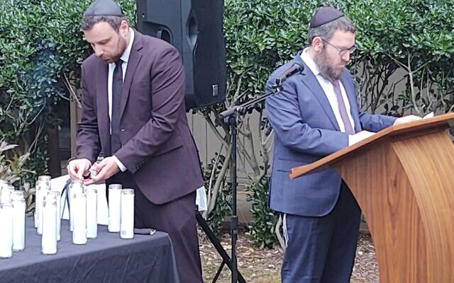 Rabbi Gurary and Alex Gandler during the memorial.