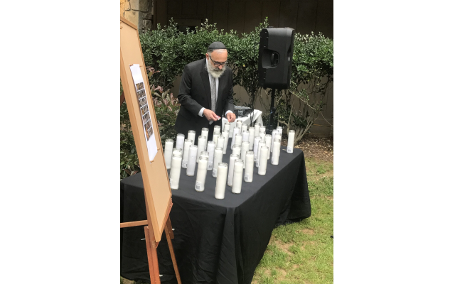 Rabbi Yossi New lights a candle.