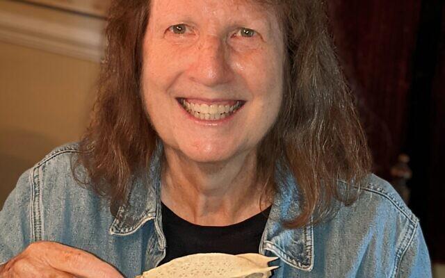 Judi Ayal holds a sun-bleached fish carcass