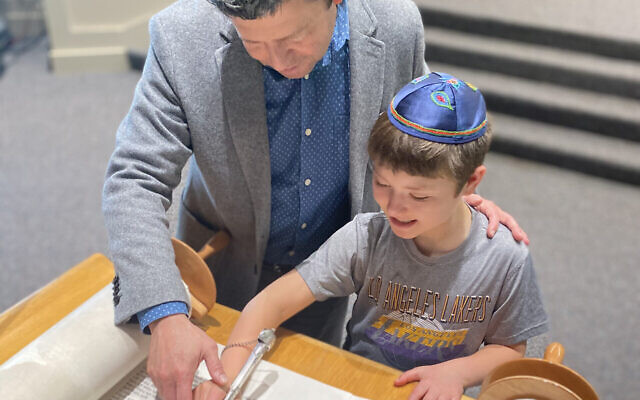 Rabbi Sernovitz studying Torah with his son Sam, preparing for his upcoming bar mitzvah.