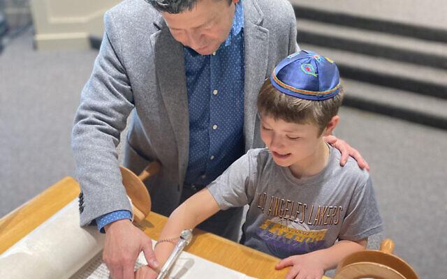 Rabbi Sernovitz studying Torah with his son Sam, preparing for his upcoming bar mitzvah.