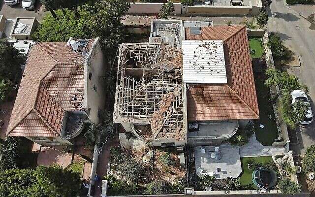 An overhead view of an Ashkelon home badly damaged by a rocket fired from Gaza on May 11, 2021. A man was seriously hurt in the attack. (JACK GUEZ / AFP)