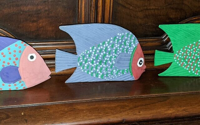 A row of painted Mexican fish.