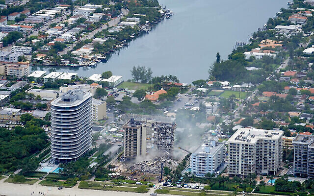 In this aerial view, the rubble at the Champlain Towers South Condo is seen, on Friday, June 25, 2021, in Surfside. The apartment building partially collapsed on Thursday. (AP Photo/Gerald Herbert)
