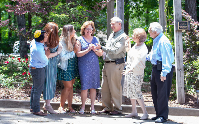 The family of Denise Whitlock gather around her after Shabbat services.