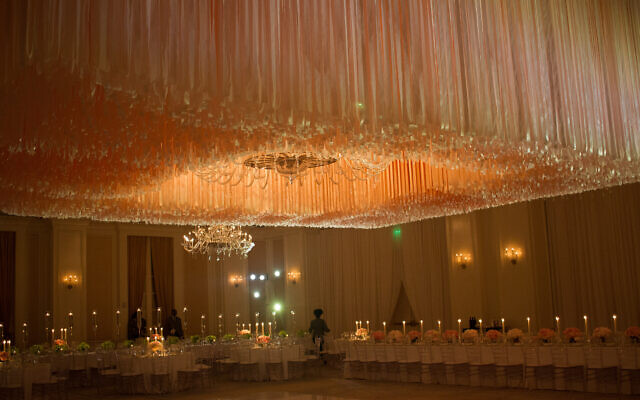 Photos by Terri Nash Photography // Barbara Roos designed this breathtaking ceiling with 10 miles of ribbon to produce a memorable event.