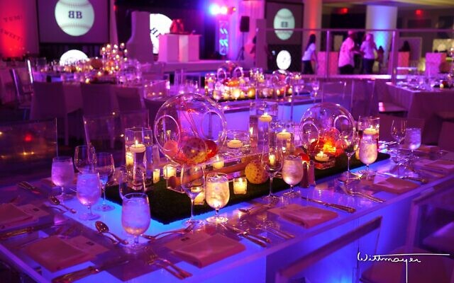 Photos by Eric Wittmayer // Barbara Roos decorated this sports bar mitzvah with a dugout and fencing to the delight of the guests.