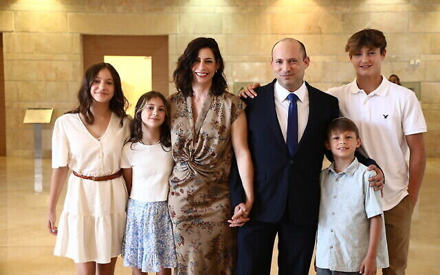 Prime Minister Naftali Bennett with his familyt, in the Knesset in Jerusalem, on June 13, 2021. (Ariel Zandberg/Yamina)