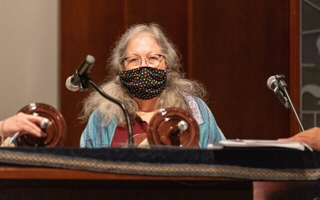 """Shelly Pirkle selected a hand-woven tallit by artisan Lois Gaylord. The band from Psalms reads: By Your light we see light."""""""