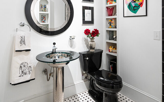 The lower-level guest bathroom is black and white art deco tile with the same sink and mirror Elton John has. Both bought from the same supplier. //Photos by Howard Mendel