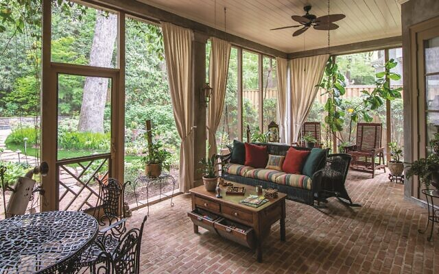 Emilie enclosed the sunroom/loggia, keeping the original brick floor.   //Photos by Howard Mendel