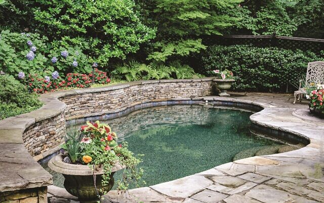 The home has a private enclosed backyard pool area. //Photos by Howard Mendel