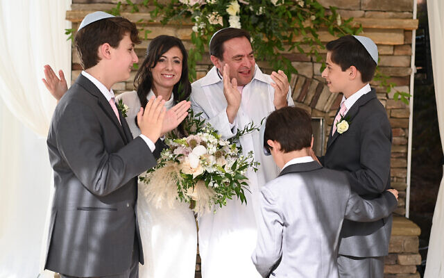 Beth Intro Photography // Jimmy Baron wore a kittel, white robe, for the ceremony as the family expresses joy.