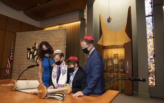 Photo by Joseph Aczel // Karen Isenberg Jones, London Jones, brother Brenin Jones and David Jones on the bimah at Temple Jeremiah in Northfield, Ill.