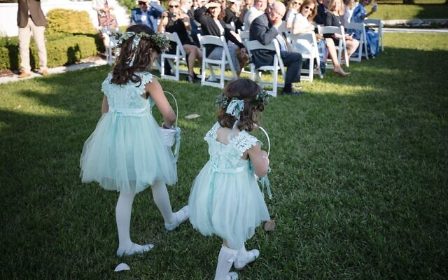 Debbie Peacock Photo & Video // Granddaughter flower girls Eleanor and Annabelle Escher made a charming entrance.