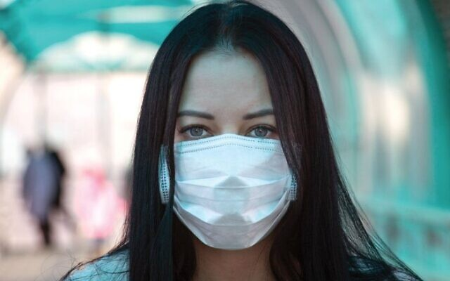 Infectious disease experts still recommend masking up in crowded indoor spaces.