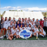 The varsity soccer team of Johns Creek High School is seen after winning the 6A championship.
