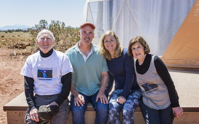 Proud parents Fred and Susan Feinberg attend grand opening, bookending their children, Clear Sky partner Hal Feinberg and Marni Ratner,