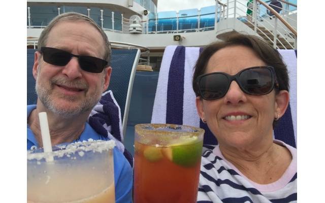 Norm and Nancy Miller sip cocktails on a cruise deck.