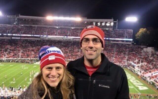 Valerie Kulbersh and Benjamin Myers enjoy a UGA vs. Auburn football game.