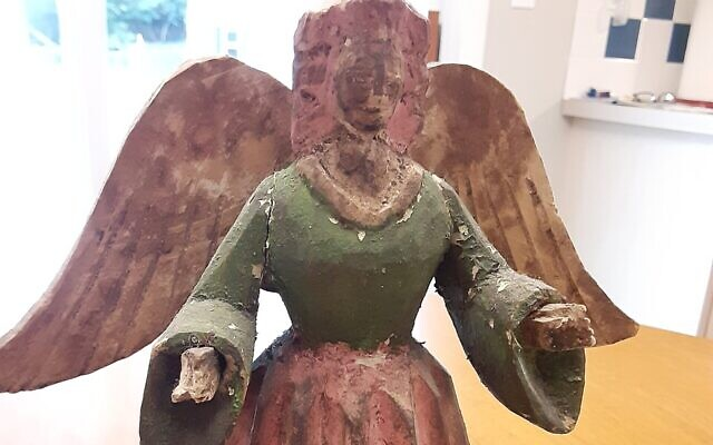 This wooden, carved angel was Euchman's first purchase.