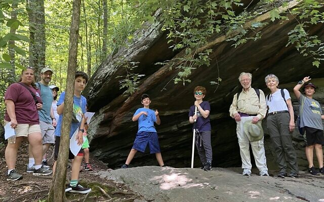 Pack 1818 and their families explore caves of Island Ford Park.