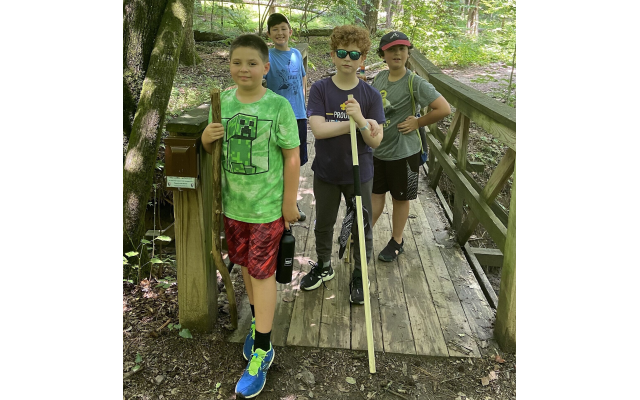 New Pack 1818 recruits and their families hike at Island Ford Park in the Chattahoochee River nature preserve.