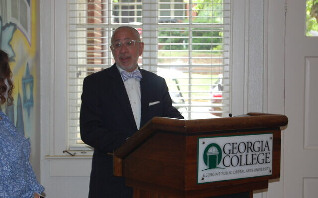 Elliot Karp addresses Hillel of GCSU during the dedication ceremony of the new house.