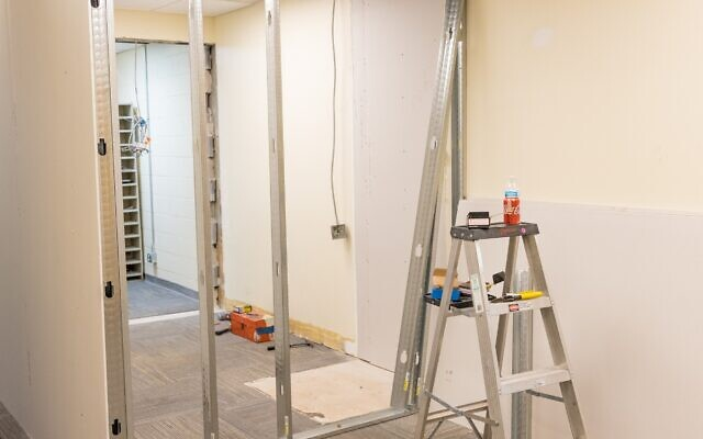 Walls at Epstein are being rebuilt to return spaces to their original configuration.