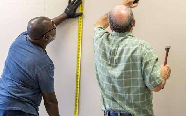 Epstein facilities team members help rebuild the school.
