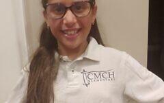 Nine-year-old Raizel Isaacs models her new Chaya Mushka shirt.