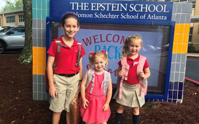 Epstein School students Micah, Ryleigh Reese, and Alexis Bank go back to school.