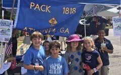 Cubs promoting Pack 1818 at Dunwoody Fourth of July Festival and Parade.