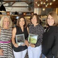 Kristin Connor, CEO of CURE, with Cindy Goldberg, Debbie Levinson and Janis Zagoria.