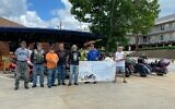 """Bikers meet at The General Muir as part of a cross-country """"deli schlep"""" to raise hunger awareness."""
