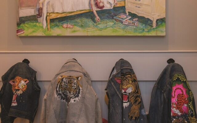 """Photos by Diane Crow// Lapin painted """"Boys in the Bedroom."""" She enjoys painting tigers and various symbols on denim vests and jackets."""
