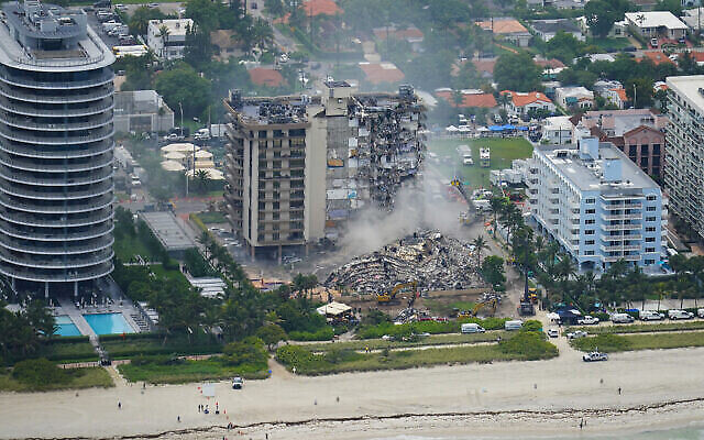 Illustrative: Rescue personnel work in the rubble at the Champlain Towers South Condo, in Surfside, Florida, June 25, 2021. (Gerald Herbert/AP)